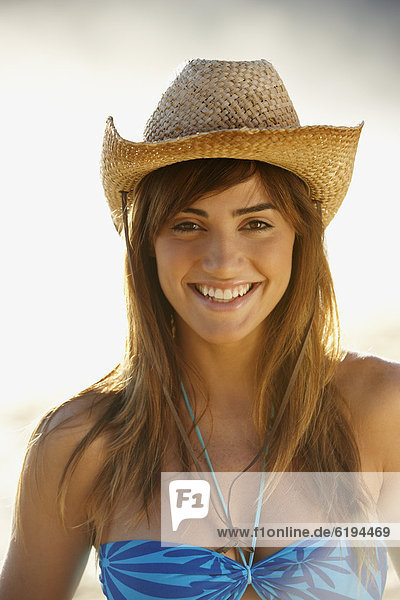 Smiling woman in straw cowboy hat