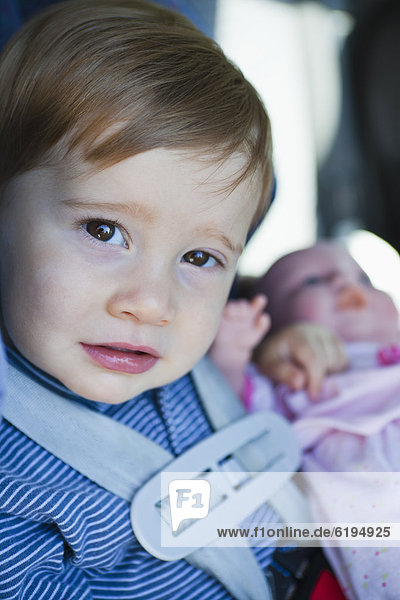 Close up of young boy in car seat, Close up of young boy in car seat