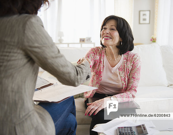 Woman shaking hands with financial advisor