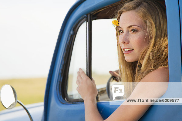 Caucasian woman driving old-fashioned truck