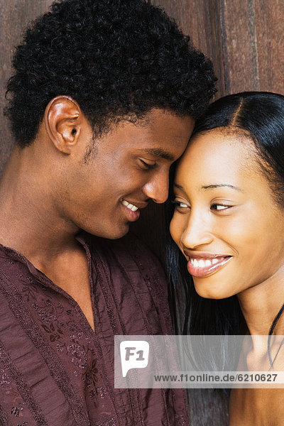 African couple smiling face to face