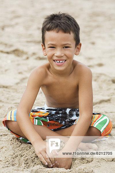 sitzend  Strand  Junge - Person  mischen  schwimmen  Mixed