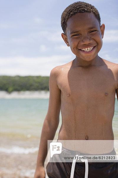 Strand  Junge - Person  Kleidung  schwimmen