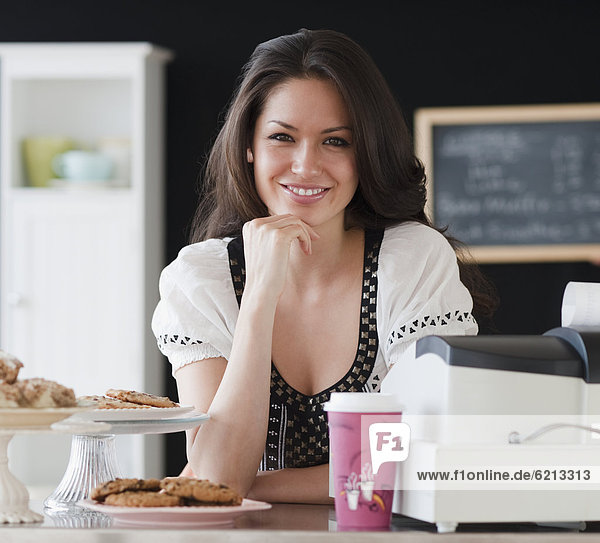 Mixed race woman working on coffee shop