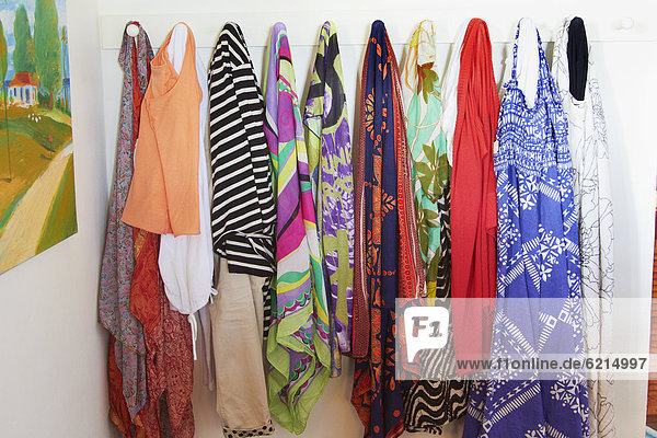 Clothes hanging on pegs