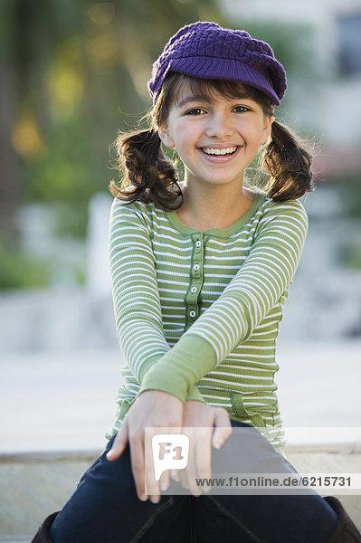 Smiling Caucasian girl in cap