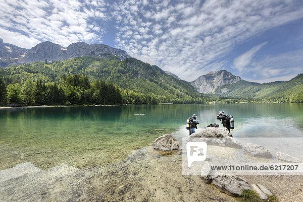 Divers  Vorderer Langbathsee lake  with Mt Spielberg  near Ebensee  Salzkammergut region  Upper Austria  Austria  Europe
