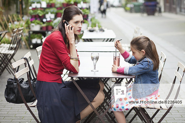 Woman with her daughter sitting in a cafe