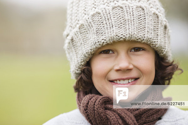 Portrait of a boy wearing a knit hat and smiling