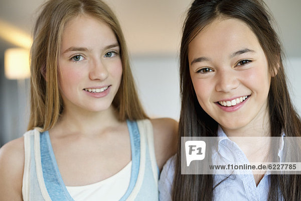 Portrait of two girls smiling