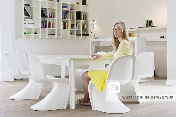 Woman sitting at a dining table