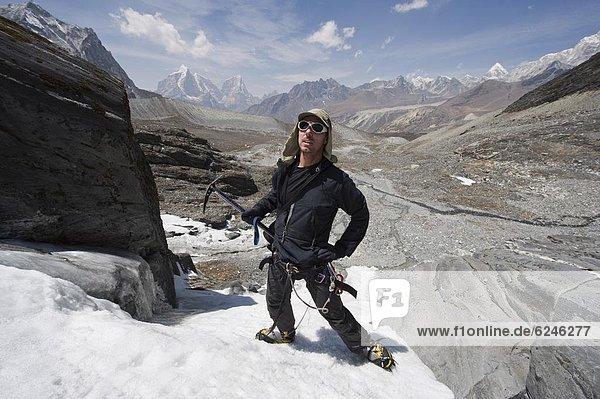 Climber on an ice wall  Chukhung Valley  Solu Khumbu Everest Region  Sagarmatha 0tio0l Park  Himalayas  Nepal  Asia