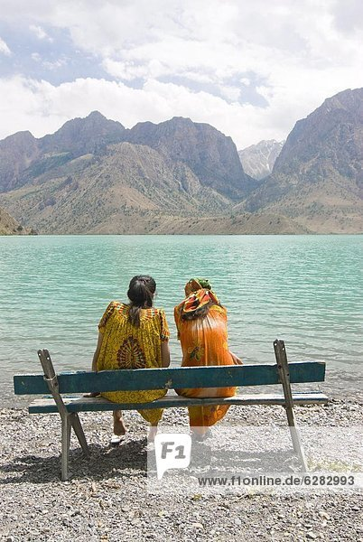 Bench at turquoise Iskanderkul Lake (Alexander Lake) in Fann Mountains  Iskanderkul  Tajikistan  Central Asia