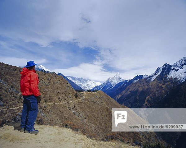 Trekker looking at Ama Dablan and other mountains of the Himalayas  Hotel Everest view  Namche Bazaar  Nepal