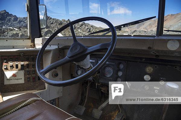 Steering wheel  bus converted into a shop  Landmannalaugar camping site  Fjallabak Nature Reserve  Highlands  Iceland  Europe
