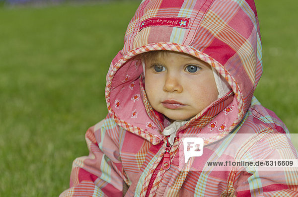 Girl  10 months  with a hoodie jacket  Dresden  Germany  Europe