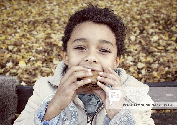 Boy eating macaroon  portrait
