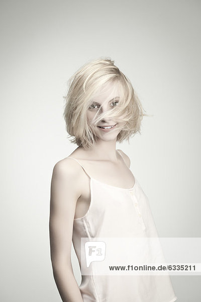 Young woman with tousled hair  portrait