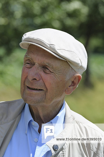 Old man with a peaked cap  Portraet  Germany  Europe  PublicGround