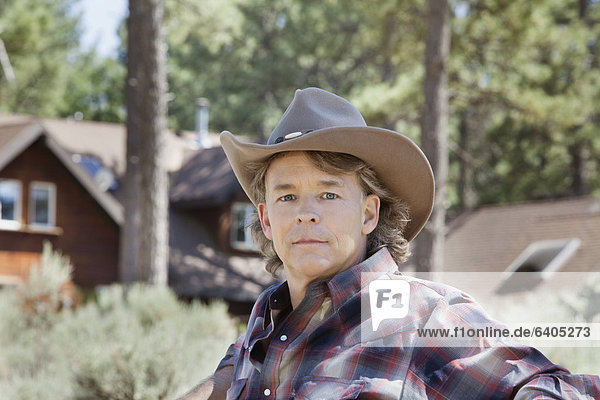Close-up portrait of a mature man wearing cowboy hat