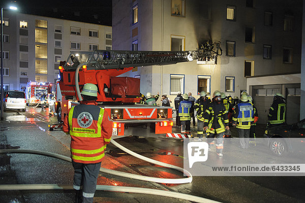 Apartment fire in an apartment building  firefighters rescueing people from a balcony  Esslingen  Baden-Wuerttemberg  Germany  Europe