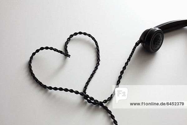 An old-fashioned telephone cord arranged into the shape of a heart