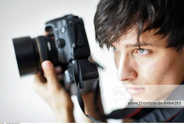 Junger Mann fotografiert *** Local Caption ***