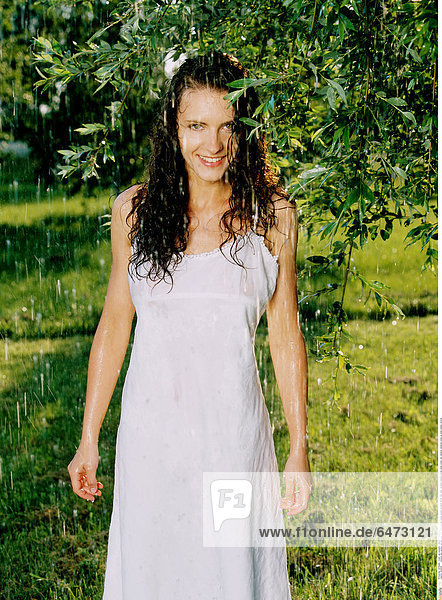 1222518 outdoor day summer garden park tree trees people young woman brunette 25-30 rest relax vacation holidays dress white water rain raindrop raindrops close up smile smiling vertical