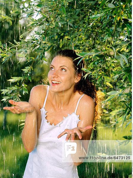 1222522 outdoor day summer garden park tree trees people young woman brunette 25-30 rest relax vacation holidays dress white water rain raindrop raindrops close up portrait smile smiling vertical