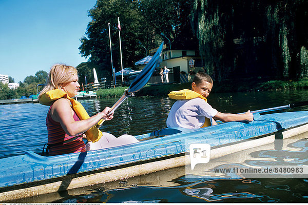 1228644 outdoor day summer people woman mother boy child 35-40 blonde dark haired hair 10-15 water lake river tree trees vacation recreation rest relax canoe oar oars life jacket smile smiling life jackets profile profiles horizontal