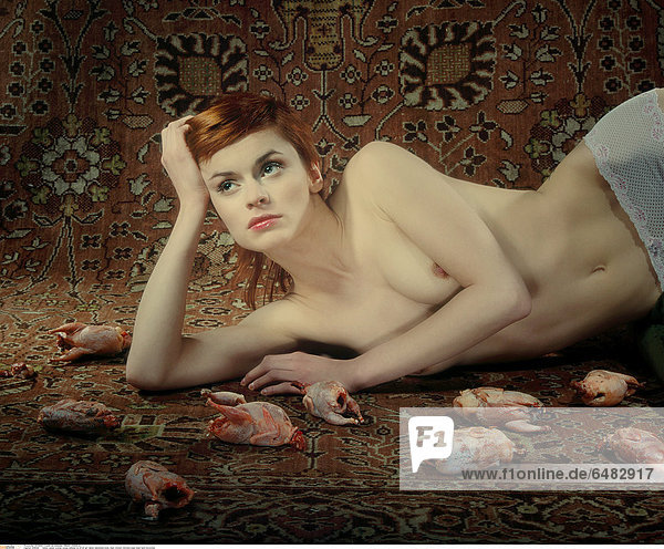 1218445 indoor carpet woman young redhead lie 20-25 girl naked nakedness body meat chicken chickens base head hand horizontal