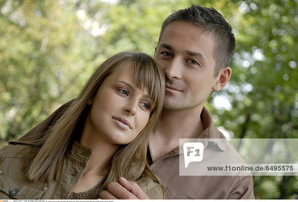 1243741 outdoor day summer people couple woman man young 20-25 girl brunette long haired dark haired 30-35 mature smile smiling blouse beige jacket blouses portrait close up horizontal