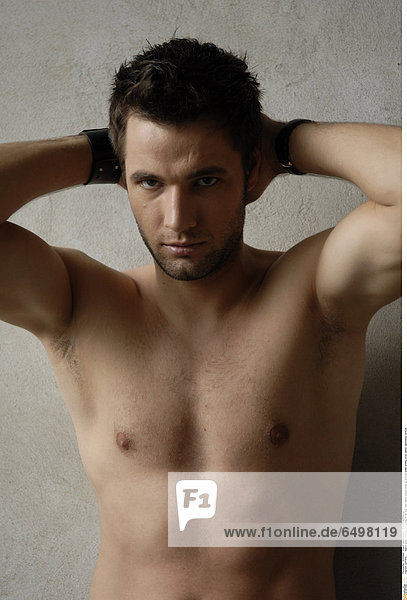 1247959 indoor studio people man young 20-25 boy dark haired bread close up portrait smile smiling torso naked nakedness vertical