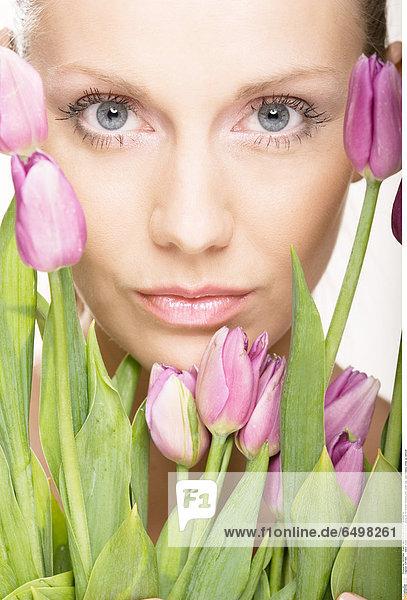1247406 indoor studio people woman young 25-30 flower flowers pink violet tulip tulips beauty close up vertical