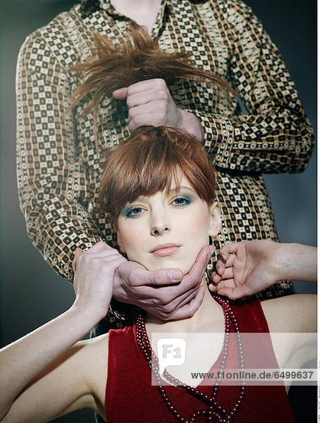 1251729 people woman girl man 20-25 fringe red haired hold touch indoor vertical
