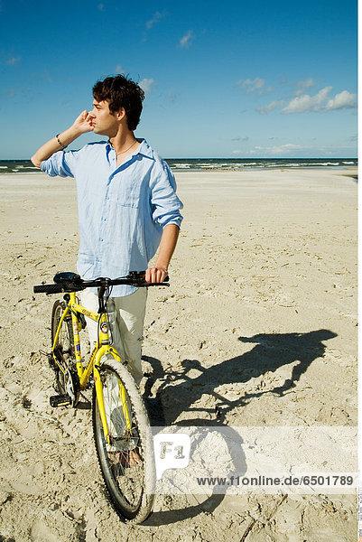 1256992 Boy with bike on the beach
