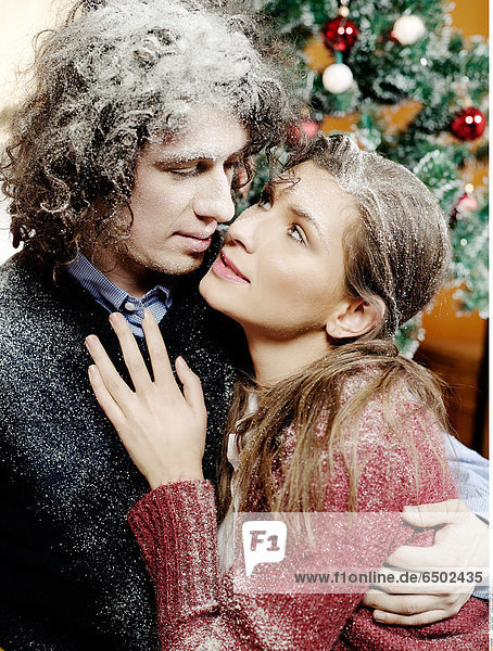 1260366 Portrait of a young couple during Christmas.
