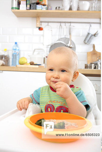 1266365 Little boy eating vegetables