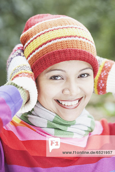 Young woman wearing a hat  scarf and gloves outdoors
