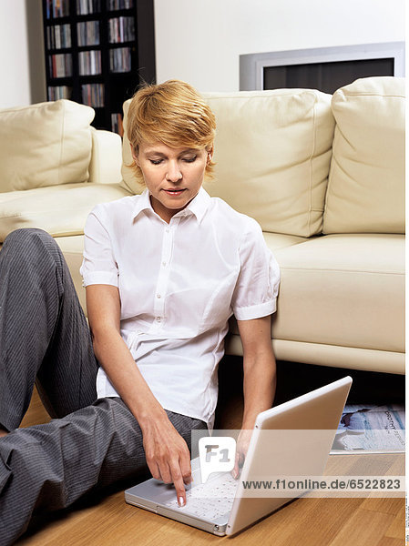 Woman with a laptop.