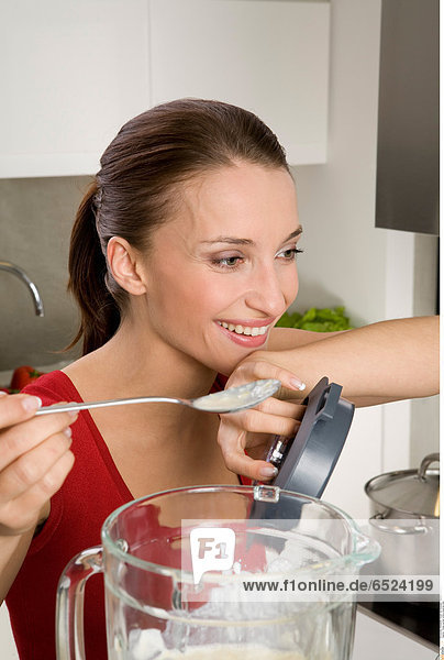 Young woman while preparing meal
