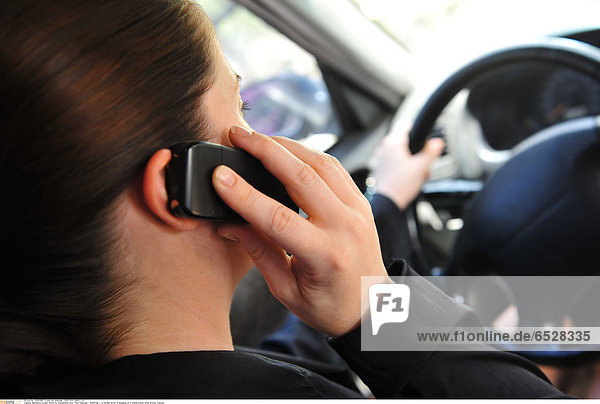 Mandatory Credit: Photo by Chameleons Eye / Rex Features ( 1254901ac ) A female driver is speaking on a mobile phone while driving Various