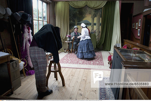 Mandatory Credit: Photo by Richard Sowersby / Rex Features ( 1293369j ) A real life photographer taking a photograph of a couple with the help of his assistant Inside a Victorian studio at Sovereign Hill open-air-museum. The museum illustrates the lives and working conditions of pioneers during the gold rush of the late 18th Century The museum is in Ballarat  state of Victoria  Australia Australia - Jan 2011