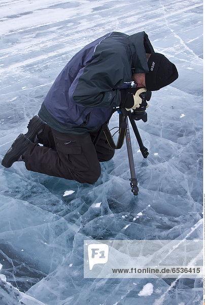 Mandatory Credit: Photo by Michael S. Nolan / SpecialistStock / Rex Features ( 1277577a ) Canadian photographer Gilles Pucheu at work near his home in Yellowknife  Northwest Territories  Canada. MORE INFO Model release number GP032810. VARIOUS