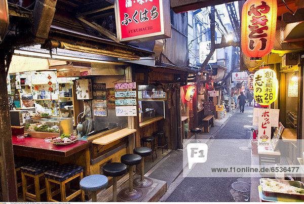 Mandatory Credit: Photo by Alex Segre / Rex Features ( 1219319aj ) Yakitori restaurants on Shomben Yokocho in Shinjuku Tokyo  Japan - 2010