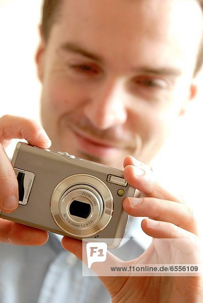 Man taking picture with a digital camera