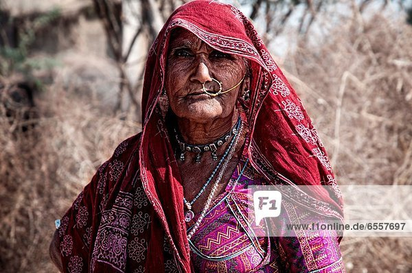 Portrait of a tribal woman in a small village around Jodhpur  Rajasthan  India
