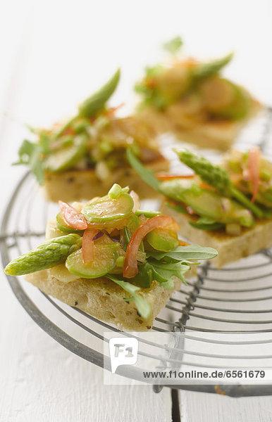 Asparagus bruschetta on grid  close up