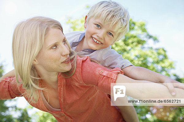 Germany  Cologne  Mother and son flying  smiling