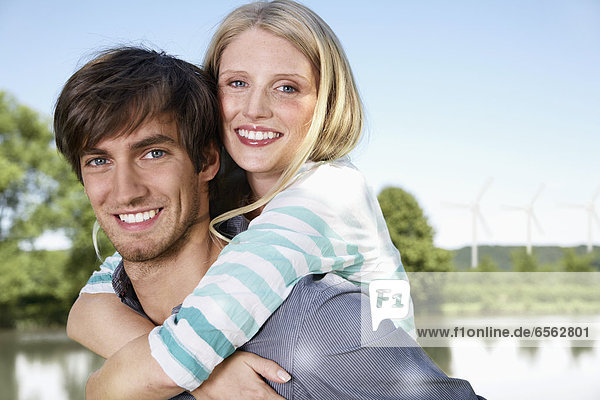 Germany  Cologne  Young couple embracing  smiling  portrait
